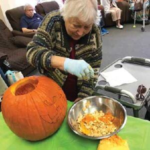 Dottie with pumpkin at adult day care