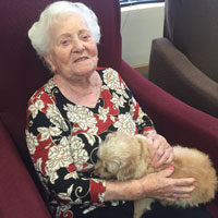 Helen with puppy at adult day care