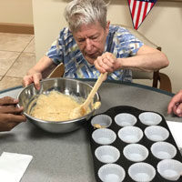 Nancy baking at adult day care