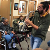 Rault with Sax at adult day care