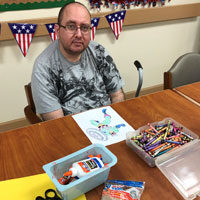 David coloring at adult day care