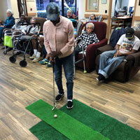 Kattie golfing at adult day care